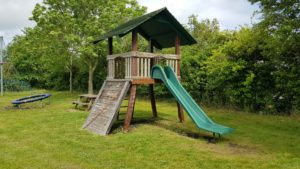 Old style wooden climbing frame with slide